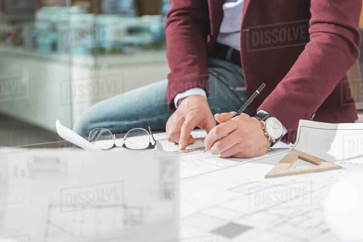 Cropped shot of architect drawing building plan Royalty-free stock photo