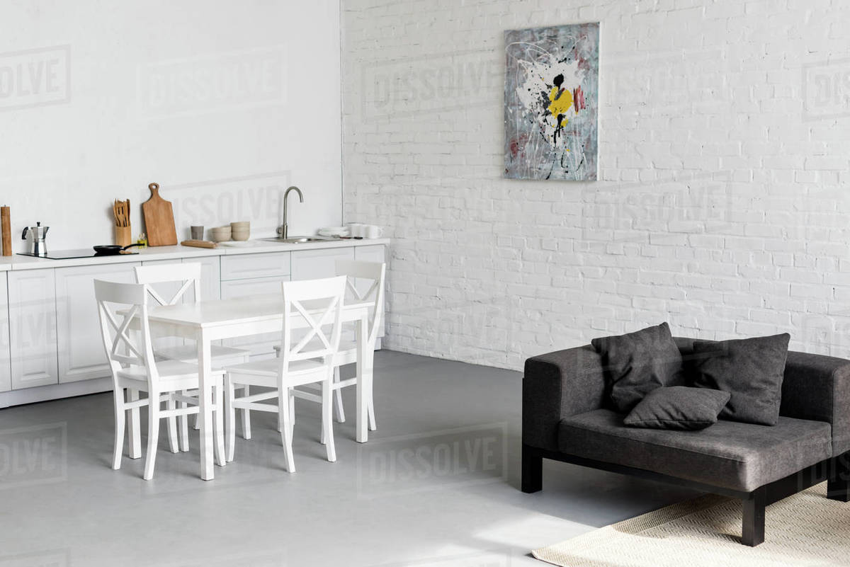 Dining table on kitchen at modern studio apartment D2115_289_357
