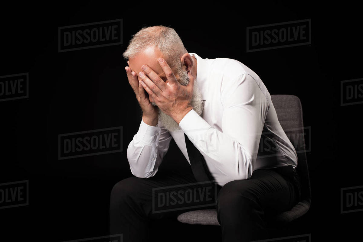 Terrific Half Length Shot Of Man In A Suit Sitting On A Chair And Hiding His Face In Hands Stock Photo Interior Design Ideas Lukepblogthenellocom