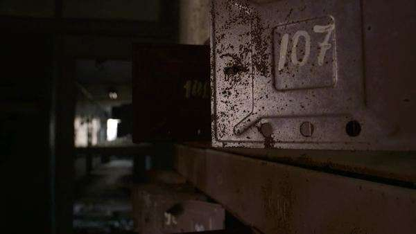 Rack focus shot of mailboxes and hallway in abandoned building Rights-managed stock video