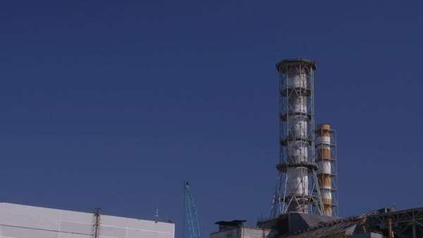 Long shot of industrial building chimney Rights-managed stock video