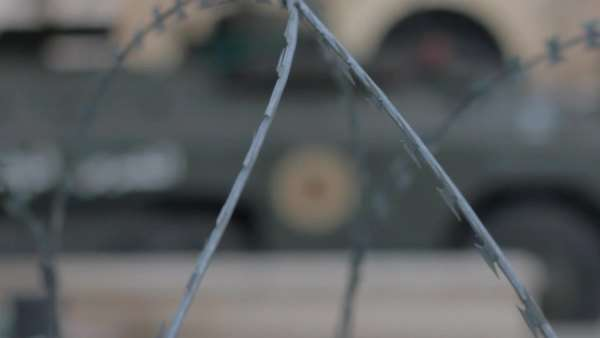 Handheld shot showing a blurred image of a barbed wire fence Royalty-free stock video