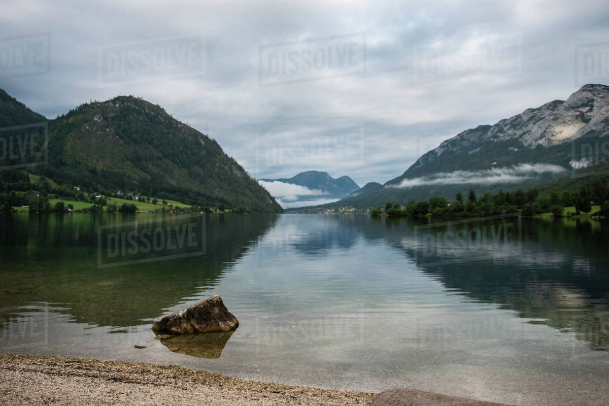 Fog over mountain lake Grundlsee in the morning, Austria  Royalty-free stock photo