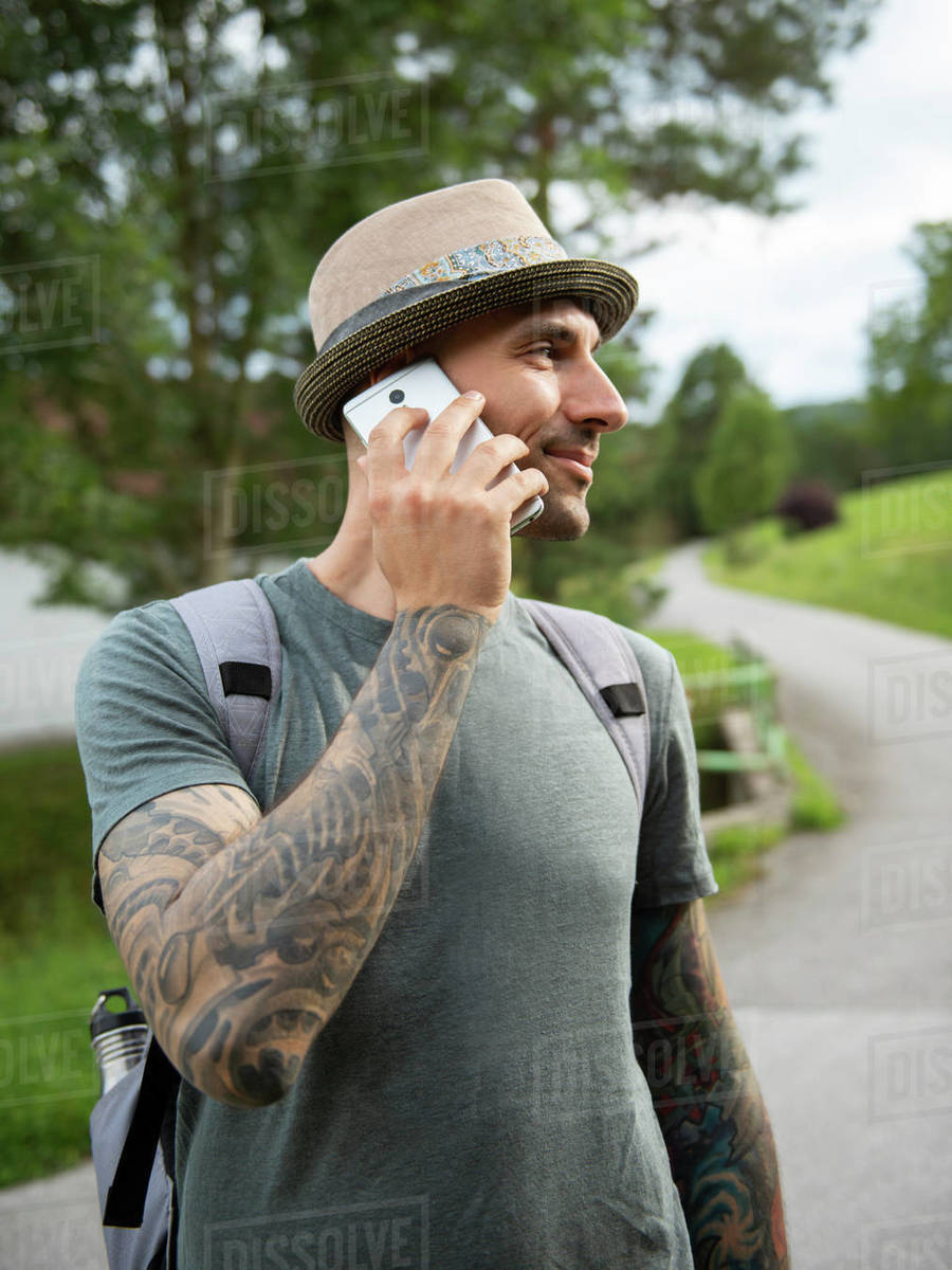 Man standing and talking by cell phone outdoor Royalty-free stock photo