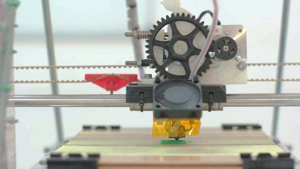 Middle zoomed front look at 3D printer creating printer spare parts Royalty-free stock video
