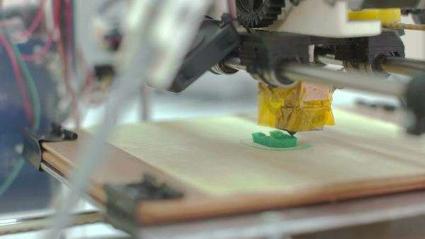 Detailed side view of 3D printer pushing out new layered object Royalty-free stock video