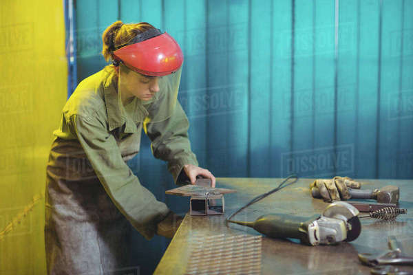 Female welder using a tool in workshop Royalty-free stock photo
