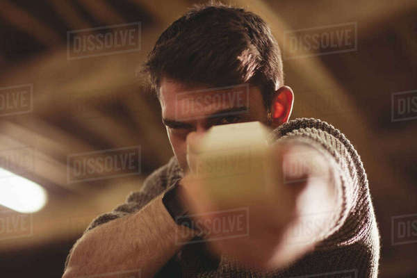 Happy carpenter working on his craft in a dusty workshop Royalty-free stock photo