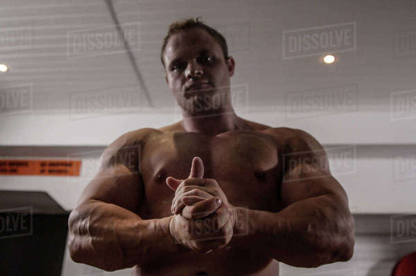 Portrait of serious body builder is looking the camera in the sport hall  Royalty-free stock photo