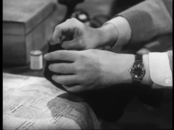 Medium shot of man darning sock at table Royalty-free stock video
