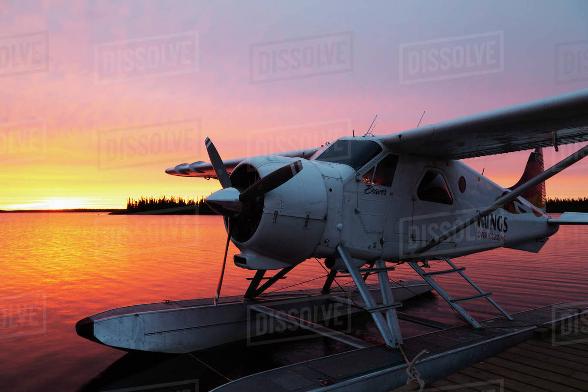 A float plane at the end of a jetty, at sunrise, in Egenolf Lake in northern Manitoba, Canada, North America Royalty-free stock photo