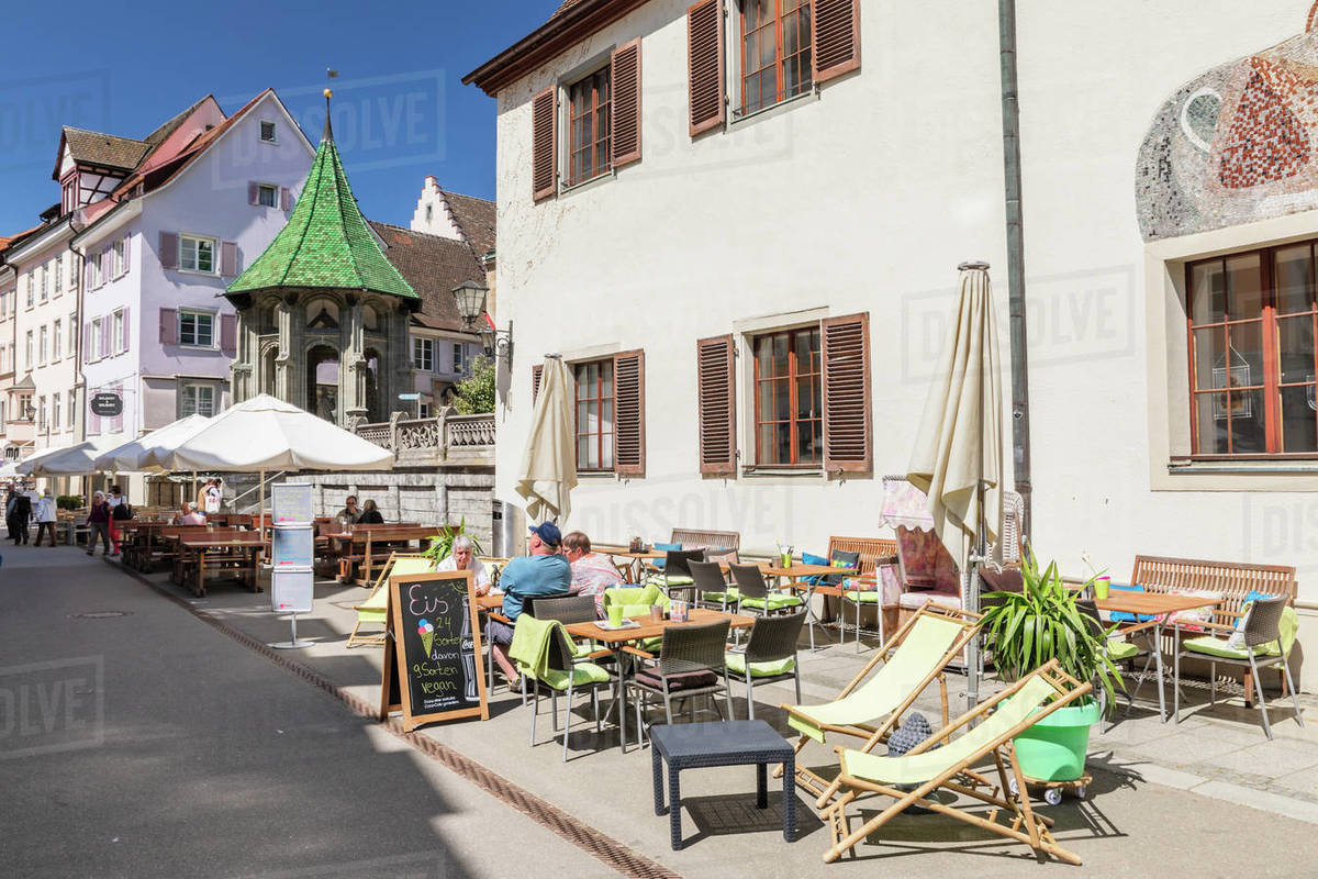 Street cafe on pedestrian area Munsterstrasse, Oelbergkapelle Chapel in the back, Uberlingen, Lake Constance, Baden-Wurttemberg, Germany, Europe Royalty-free stock photo