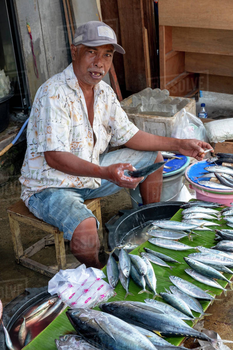 A man selling fish in the local city market, Masohi, Seram, Indonesia, Southeast Asia, Asia Royalty-free stock photo