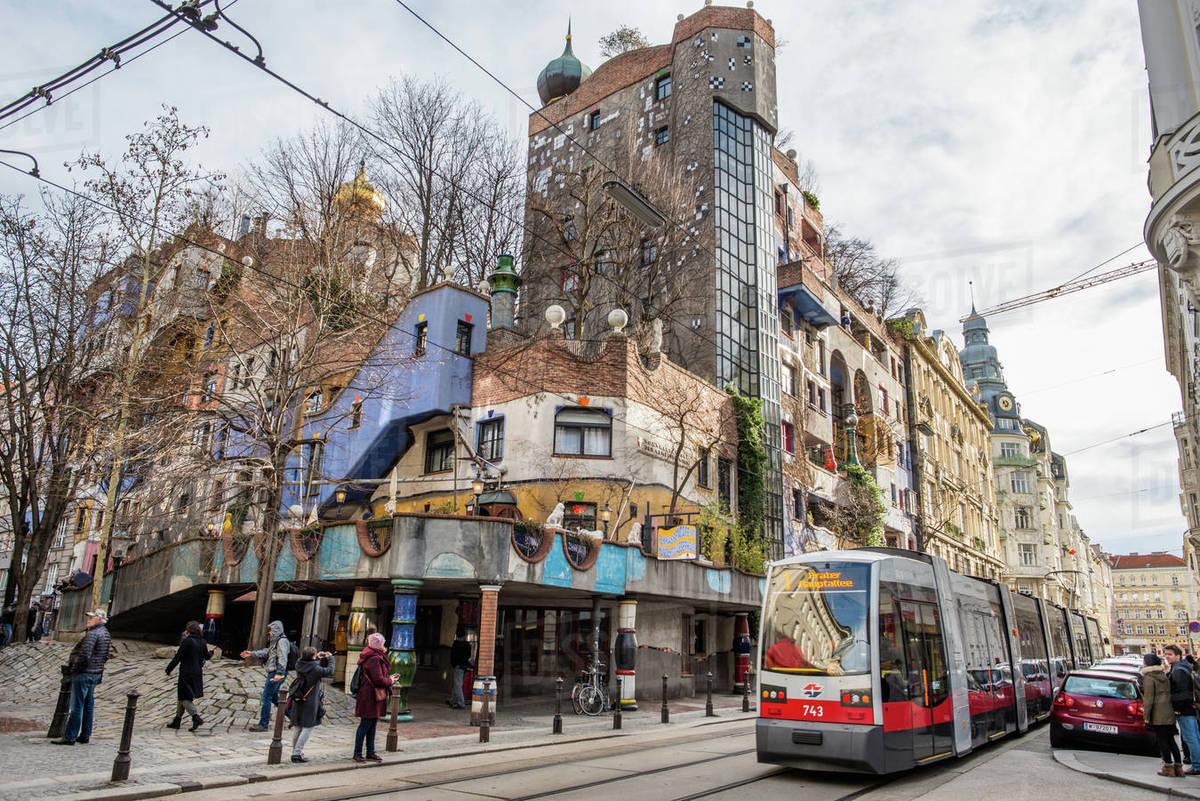 Tram at Hundertwasserhaus, expressionist landmark and public housing, designed by Friedenreich Hundertwasser in Vienna, Austria, Europe Royalty-free stock photo