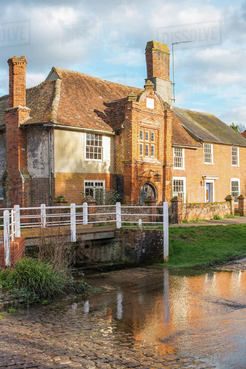 Fifteenth century Ye Olde River House dating from 1490 reflected in the ford, in the village of Kersey, Suffolk, England, United Kingdom, Europe Royalty-free stock photo