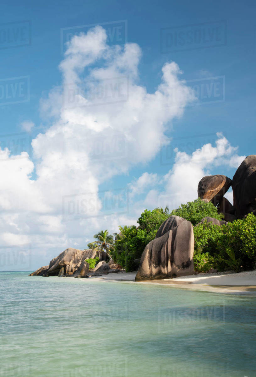Distinctive large granite boulders and palm trees on Anse Source d'Argent, La Digue, Seychelles, Indian Ocean, Africa Royalty-free stock photo