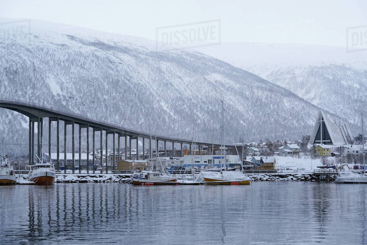 Tromso Harbour, the Bruvegen Bridge and Tromsdalen Church (Arctic Cathedral), Tromso, Troms County, Norway, Scandinavia, Europe Royalty-free stock photo