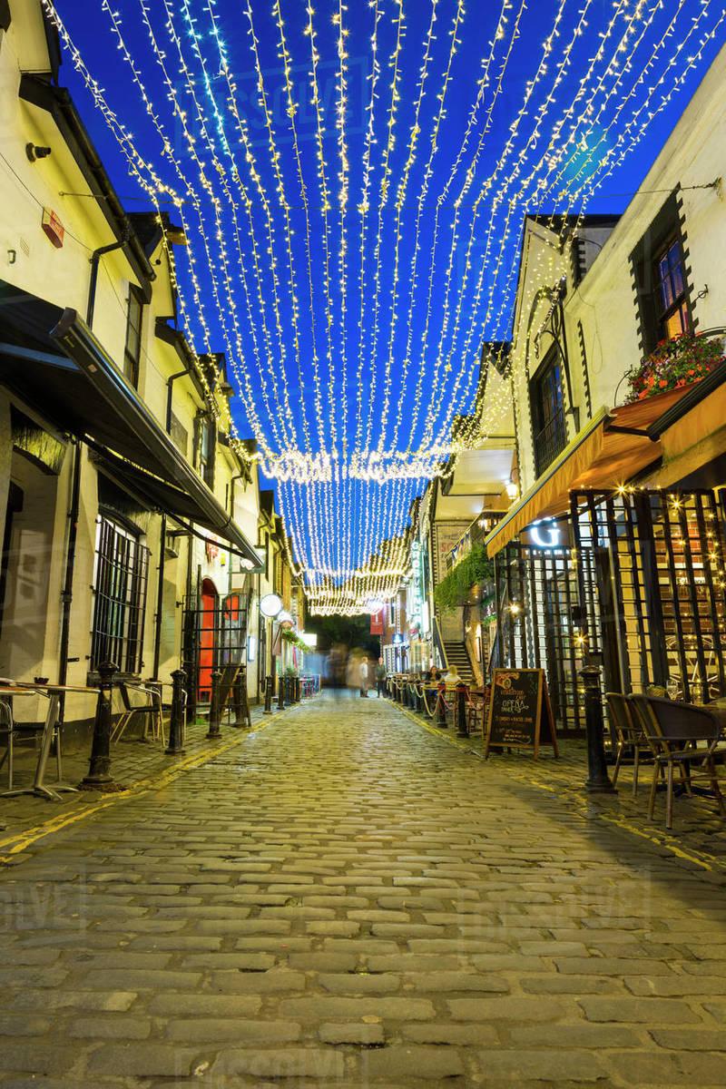 Cobbled backstreet of Ashton Lane, West End, Glasgow, Scotland, United Kingdom, Europe Royalty-free stock photo