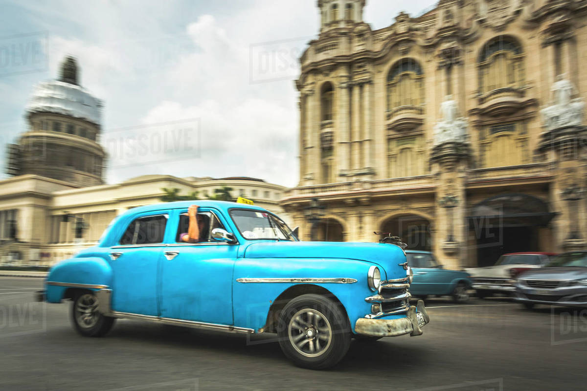 Turquoise American classic car taxi outside El Capitolio in Havana, La Habana, Cuba, West Indies, Caribbean, Central America Royalty-free stock photo