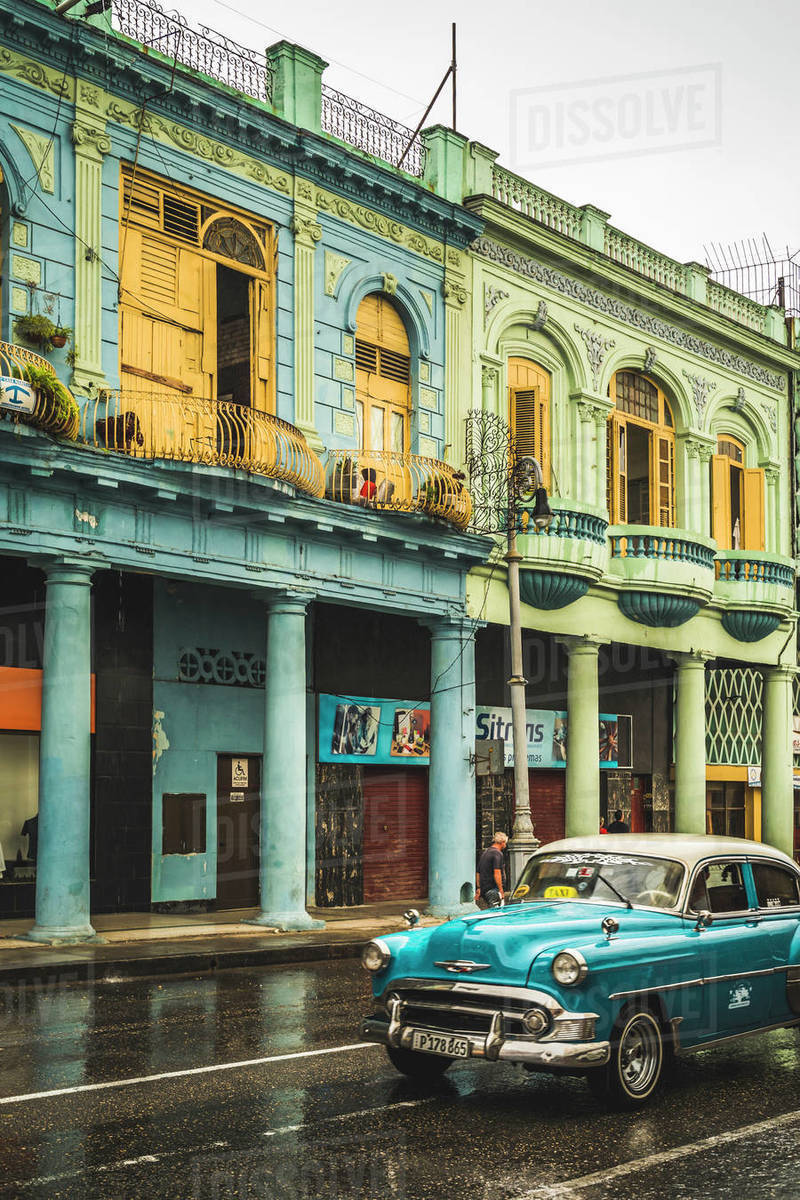 Turquoise vintage taxi in the rain, La Habana (Havana), Cuba, West Indies, Caribbean, Central America Royalty-free stock photo