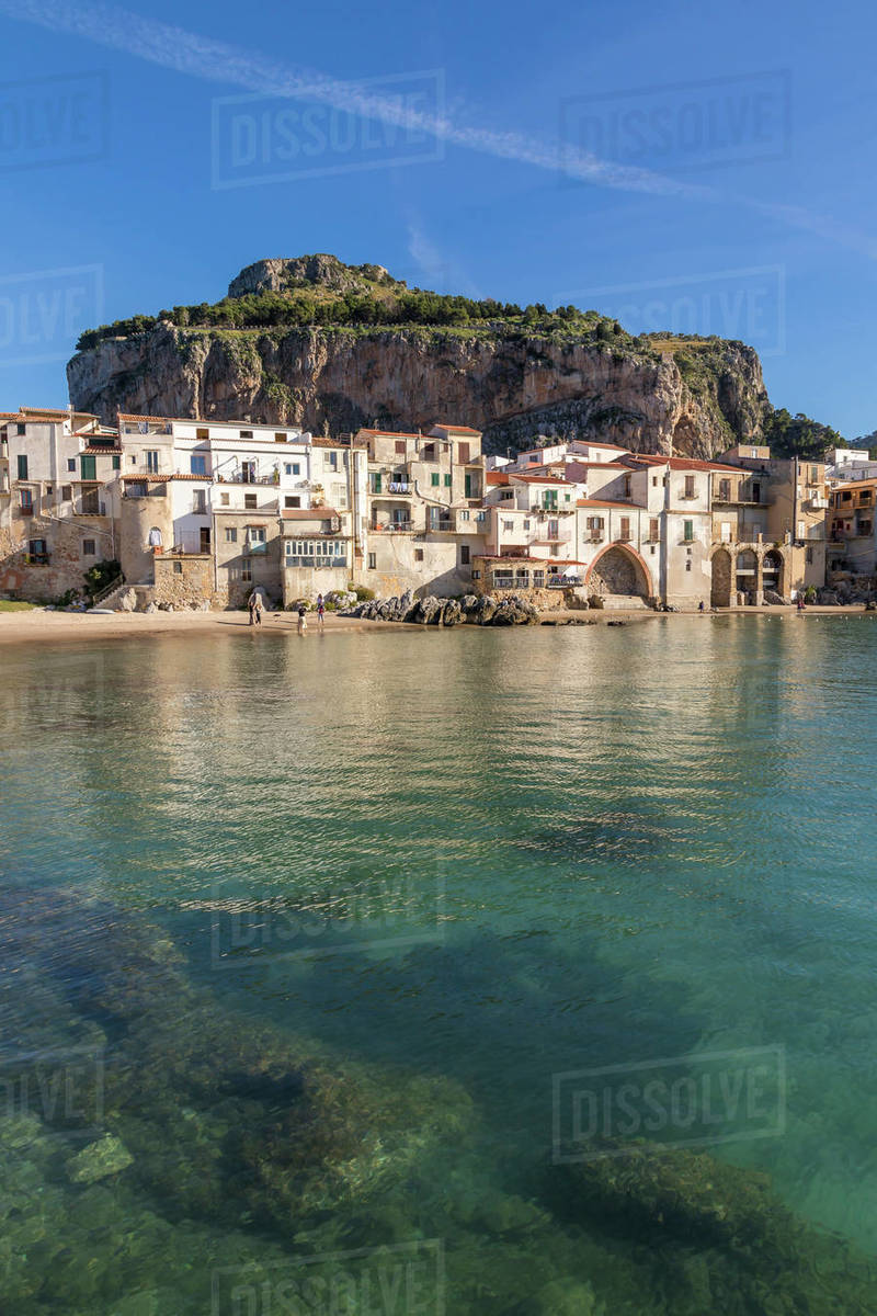 The old town of Cefalu with Rocca di Cefalu in the background, Cefalu, Sicily, Italy, Mediterranean, Europe Royalty-free stock photo