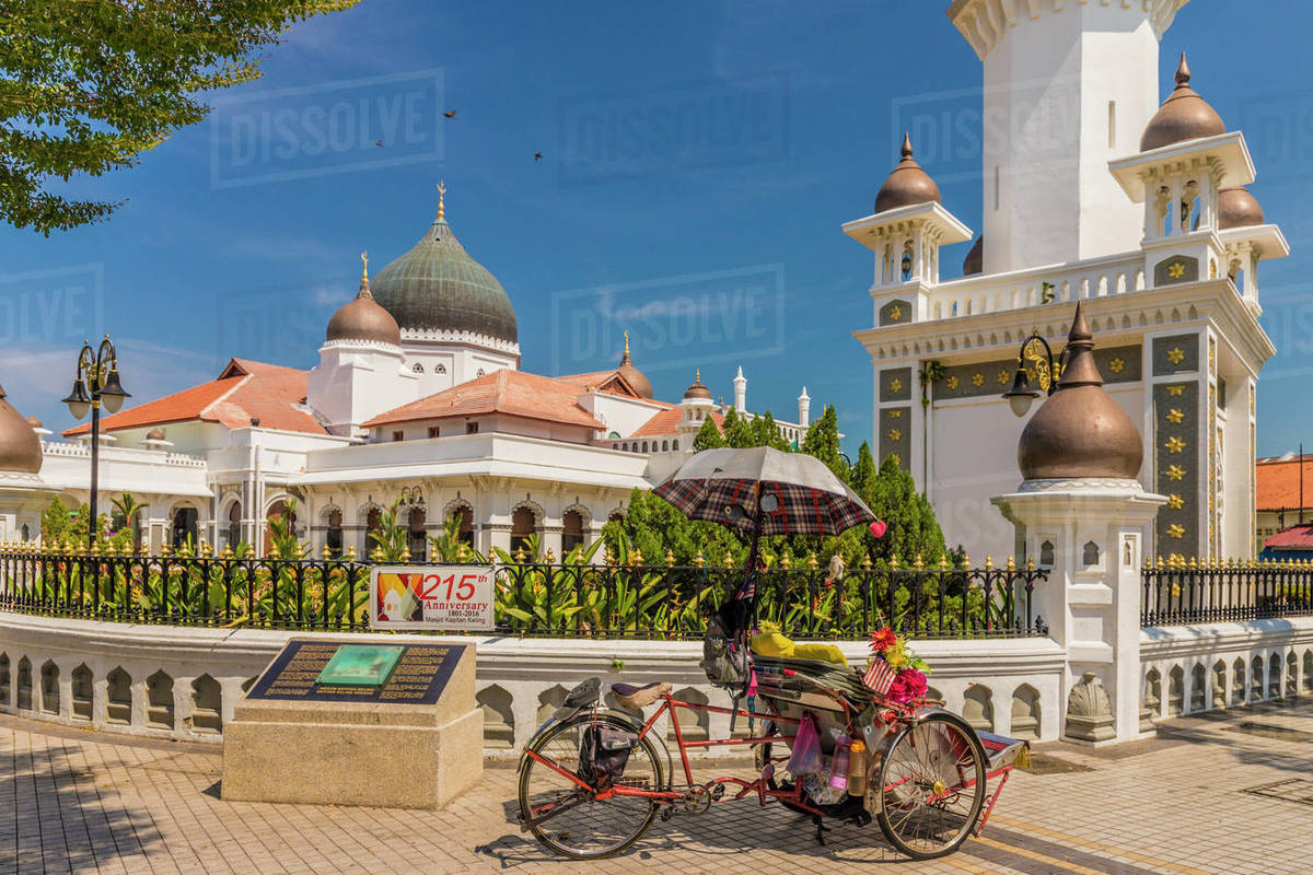 A local rickshaw (tuk tuk) outside Kapitan Keling Mosque, George Town, Penang Island, Malaysia, Southeast Asia, Asia Rights-managed stock photo