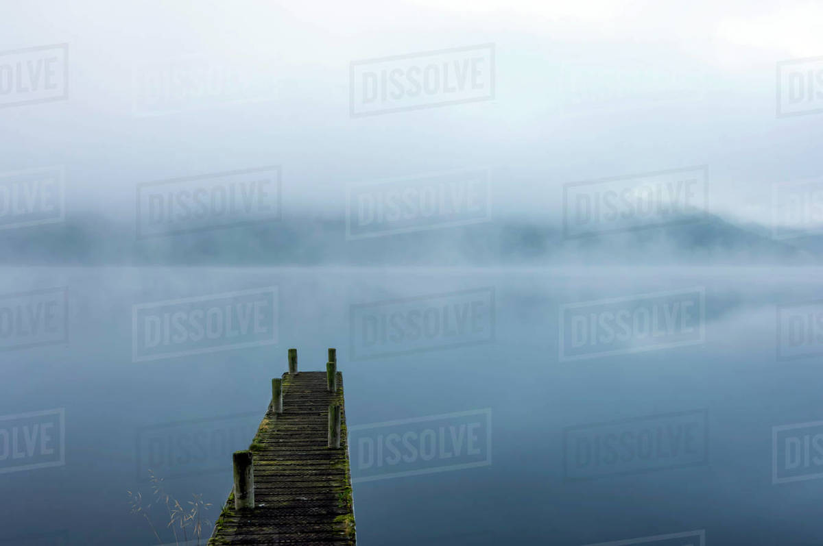 Morning mist, Ullswater, Lake District National Park, UNESCO World Heritage Site, Cumbria, England, United Kingdom, Europe Royalty-free stock photo