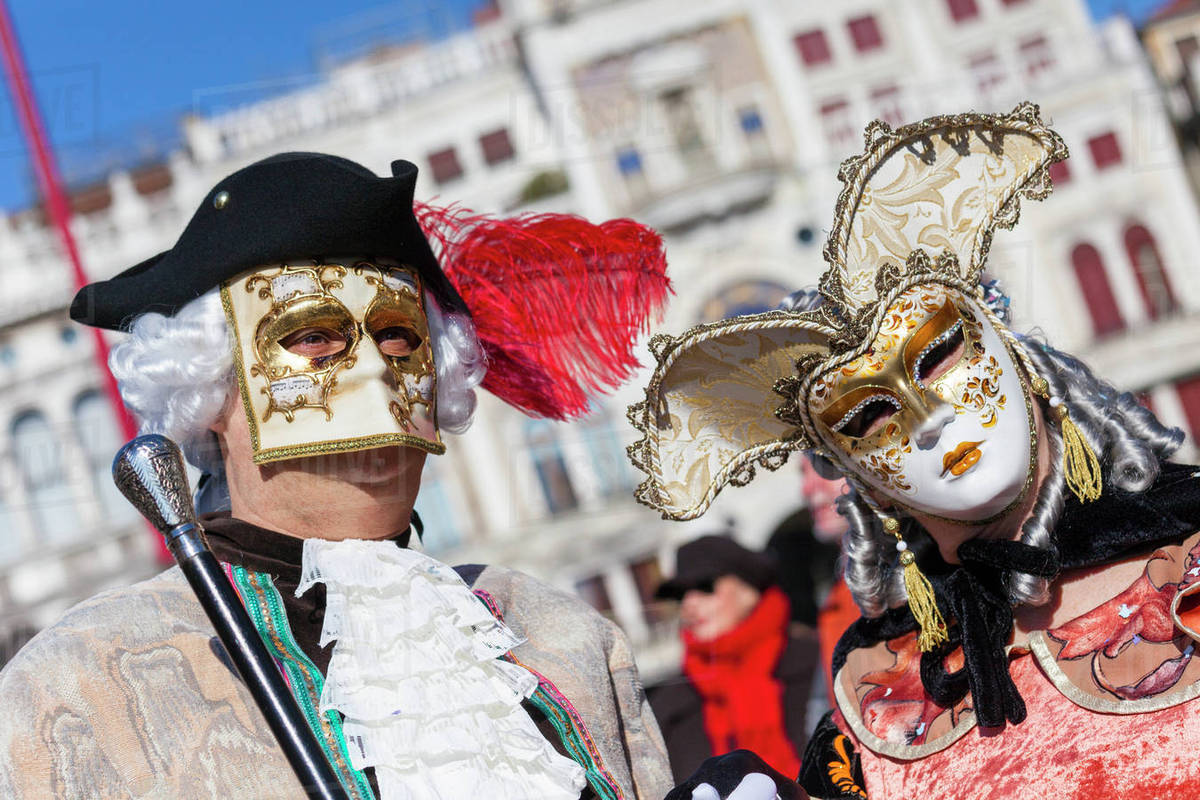 Colourful masks and costumes of the Carnival of Venice, famous D246_23_203