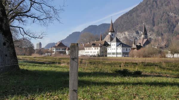 Schlosskirche and Rom.-Katholische Kirchgemeinde, Interlaken, Jungfrau region, Bernese Oberland, Swiss Alps, Switzerland, Europe Royalty-free stock video