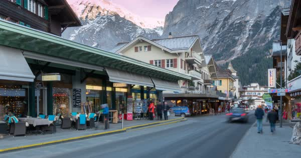 Traffic in Grindelwald village, Jungfrau region, Bernese Oberland, Swiss Alps, Switzerland, Europe Royalty-free stock video