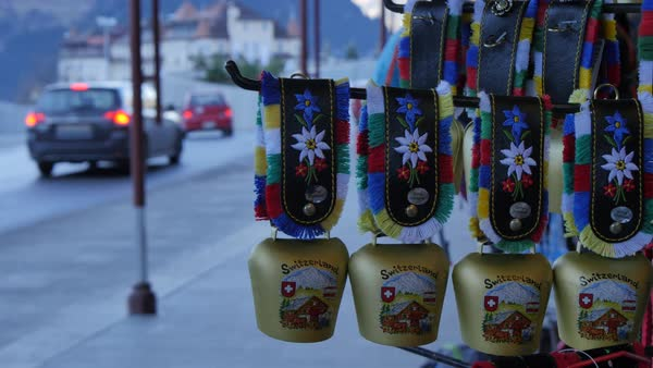Souvenir Swiss cow bells on the main street, Grindelwald, Jungfrau region, Bernese Oberland, Swiss Alps, Switzerland, Europe Rights-managed stock video