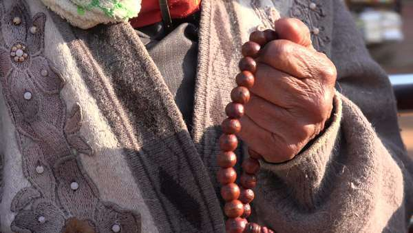 Senior woman uses prayer beads in Kathmandu Royalty-free stock video
