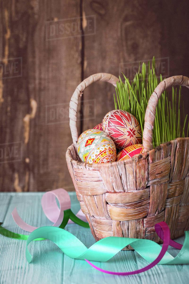 Happy Easter - basket with beautiful Easter egg Pysanka handmade. ukrainian traditional Royalty-free stock photo
