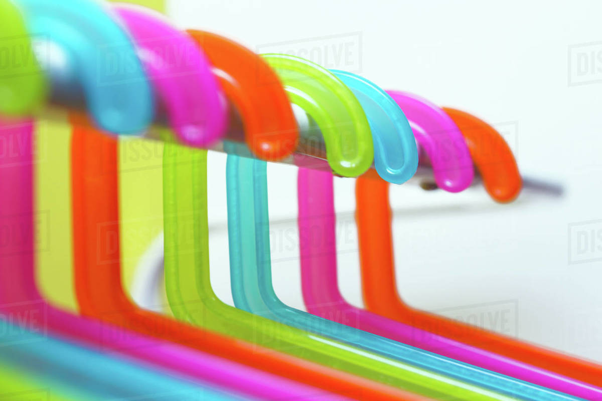 Multicolored hangers on white background with small depth of field Royalty-free stock photo