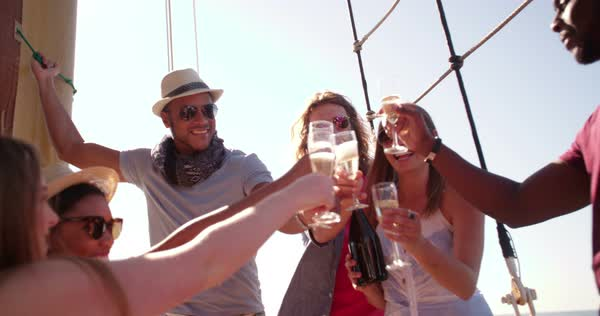 Beautiful girl enjoying a party on a yacht with friends on a summer day with sunflare Royalty-free stock video