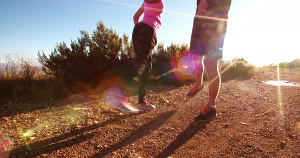 Young couple warming up before running outdoors with stretching exercise together Royalty-free stock video