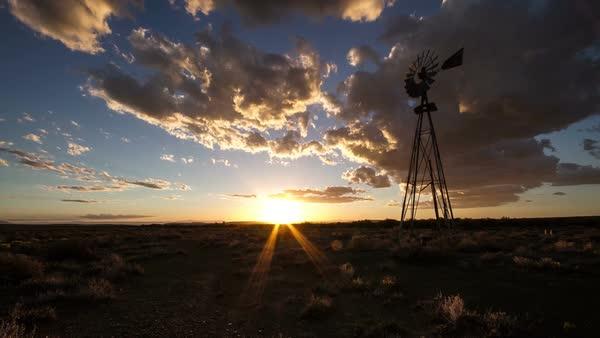 Timelapse of windmill with clouds and sunset in American desert Royalty-free stock video