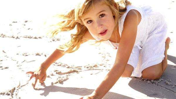 Little Girl is painting in the sand Royalty-free stock video
