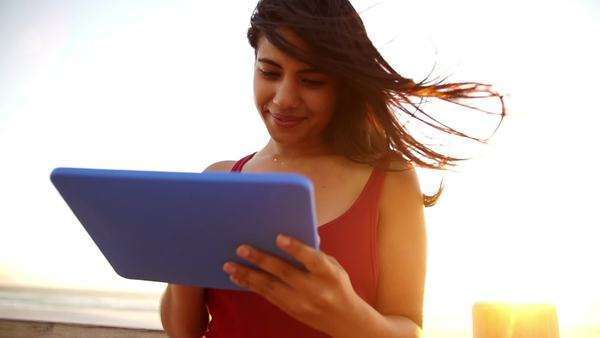 Woman using tablet pc on the beach Royalty-free stock video