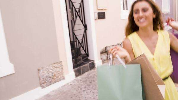Smiling Woman walking down street with her shopping bags Royalty-free stock video