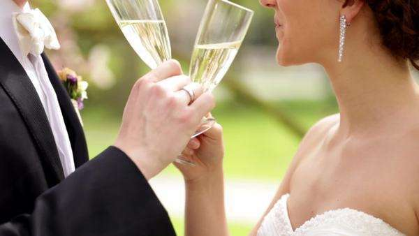 Newlyweds drinking champagne on their sunny wedding day Royalty-free stock video