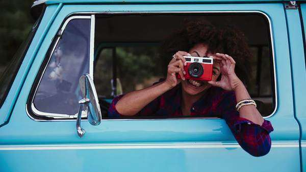 Girl with retro camera in old car Royalty-free stock video
