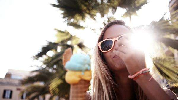 Girl with sunglasses eating ice cream Royalty-free stock video