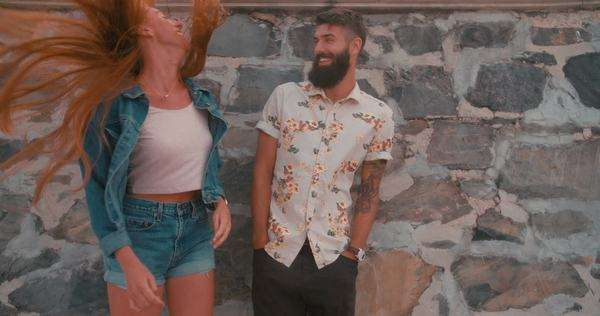 Retro style image hipster guy standing next to a hipster girl flinging her red hair wildly in slow motion Royalty-free stock video