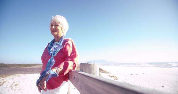 Portrait of a happy active senior woman enjoying time at the beach Royalty-free stock video
