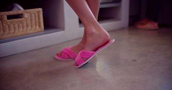 Woman wearing pink slippers in house Royalty-free stock video