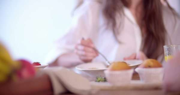 Woman eating fresh berries in a bowl of cereal in the morning Royalty-free stock video