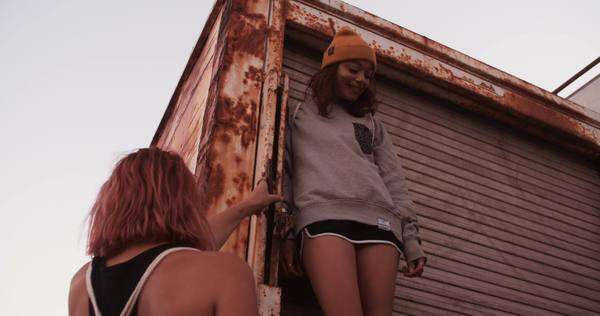 Teen girl friends with grunge style hanging out with each other on the back of an old truck Royalty-free stock video