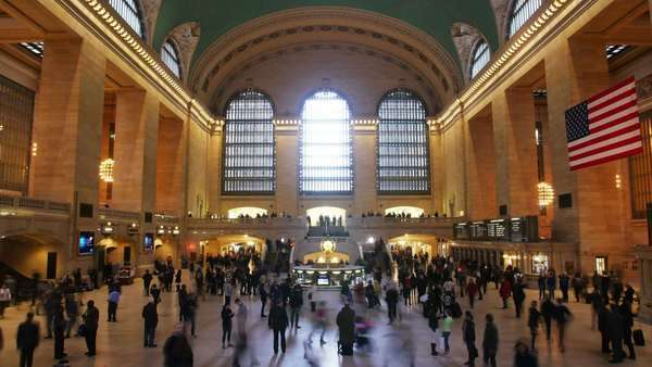 Busy people rushing through Grand Central Station in New York to catch their trains and subways in short Timelapse Royalty-free stock video