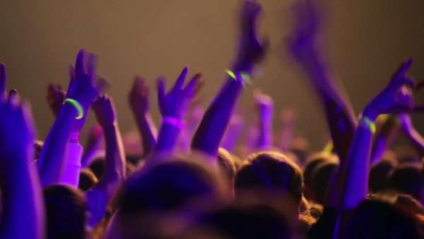 Many people at rave party, view from behind, hand and heads Royalty-free stock video